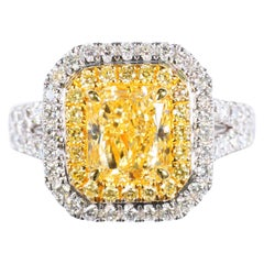 GIA Certified Light Yellow Radiant Cut and White Diamond Ring 3.25 Cts Total Dia