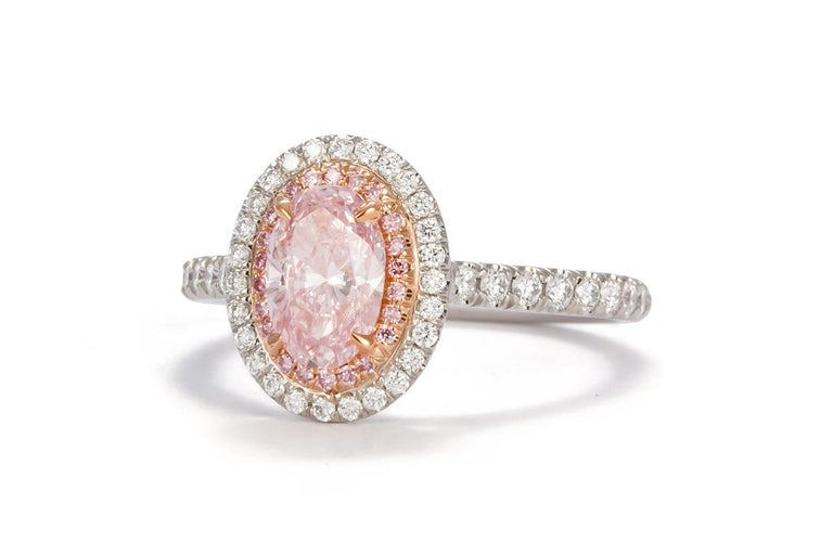 Modern GIA Certified Natural Fancy Pink Oval Diamond Halo Ring 1.58 Carat For Sale