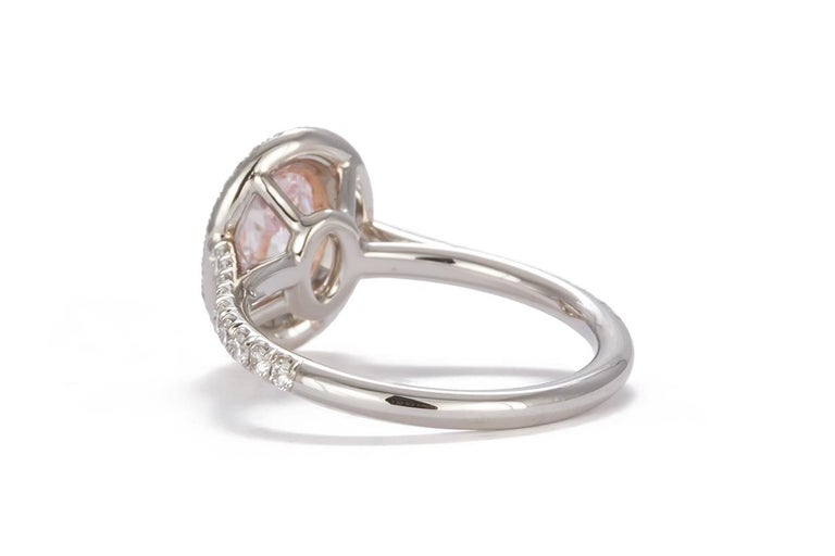Oval Cut GIA Certified Natural Fancy Pink Oval Diamond Halo Ring 1.58 Carat For Sale