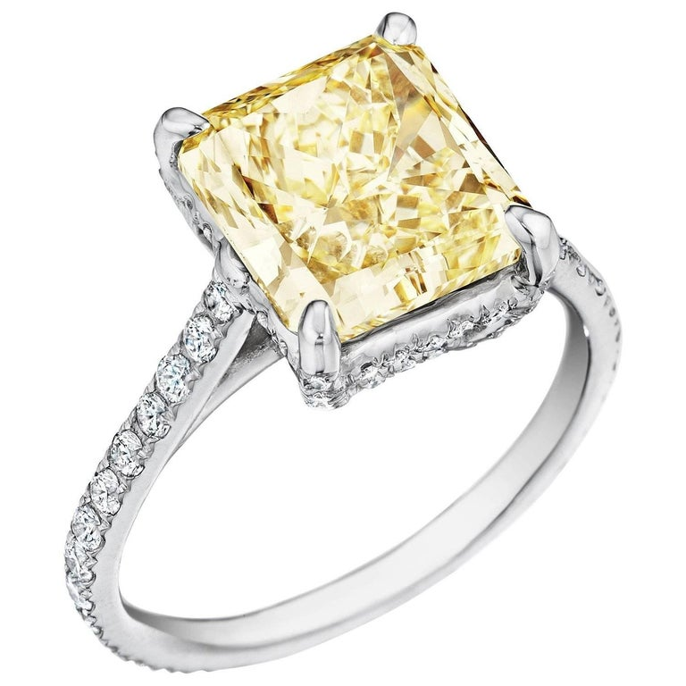 This phenomenal Chardonnay Diamond® ring has a 3.80cts. center radiant cut diamond which is Y-Z color and VVS1 clarity. The diamond has a unique serial number on the girdle and the Chardonnay Diamond® Logo. The stone is set in 18kt. white & yellow