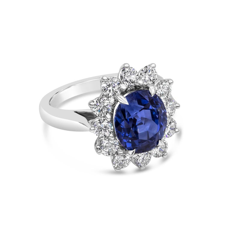 A color-rich piece of jewelry showcasing a rare 5.00 carat blue sapphire certified by GIA as natural with no indications of heat treatment. Surrounding the sapphire is a row of round brilliant diamonds weighing 1.30 carats total, in a floral motif