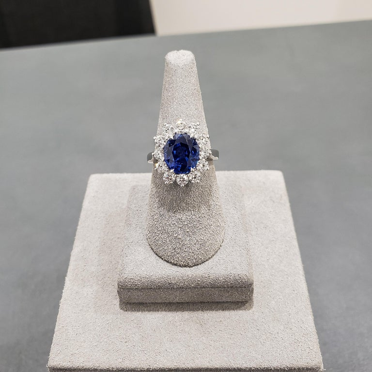 Contemporary GIA Certified No Heat Blue Sapphire and Diamond Halo Engagement Ring For Sale