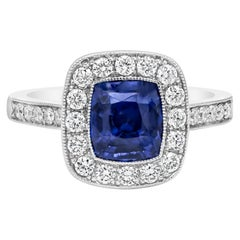 GIA Certified No Heat Blue Sapphire and Diamond Halo Engagement Ring