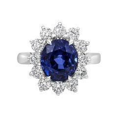 Roman Malakov, No Heat Blue Sapphire and Diamond Halo Engagement Ring