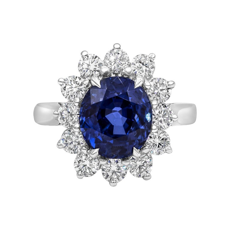 GIA Certified No Heat Blue Sapphire and Diamond Halo Engagement Ring For Sale