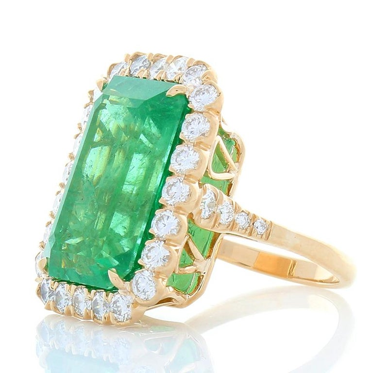 This is a 16.28 carat octagon cut grass-green emerald with subtle undertones of yellow. The gem source is Zambia. Its color is evenly distributed through the gem; its transparency is excellent. The gem measures 18.45x12.19x9.68MM. The length to
