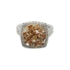 GIA Certified Orange-Yellow Fancy Intense with a Clarity of VS 18K Halo Ring