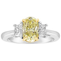 GIA Certified Oval Cut Yellow Diamond Three-Stone Engagement Ring