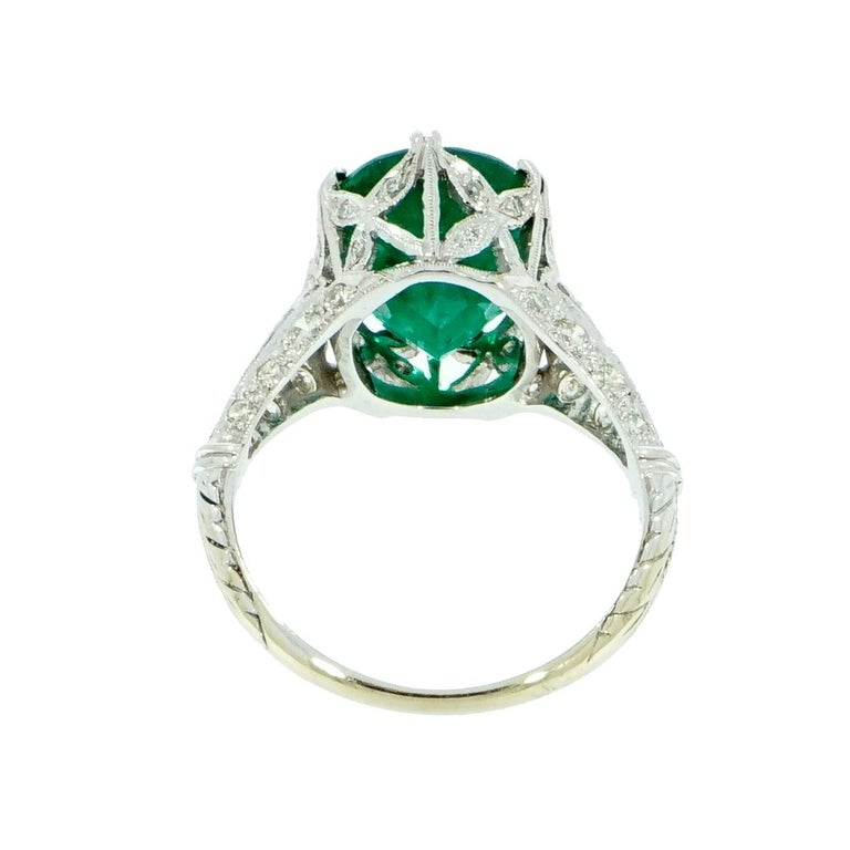 A Timeless Emerald ring… A fine example of Art Deco jewelry in its entire splendor!  Ideal to be worn alone or as a lovely alternative Vintage Engagement Ring.  A Family Heirloom Quality Keepsake, to have and to hold Forever!  The oval Emerald is