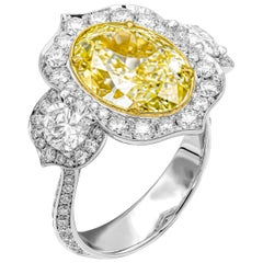 GIA Certified Oval Fancy Yellow 6.02 Carat 3-Stone Arabic Style Ring