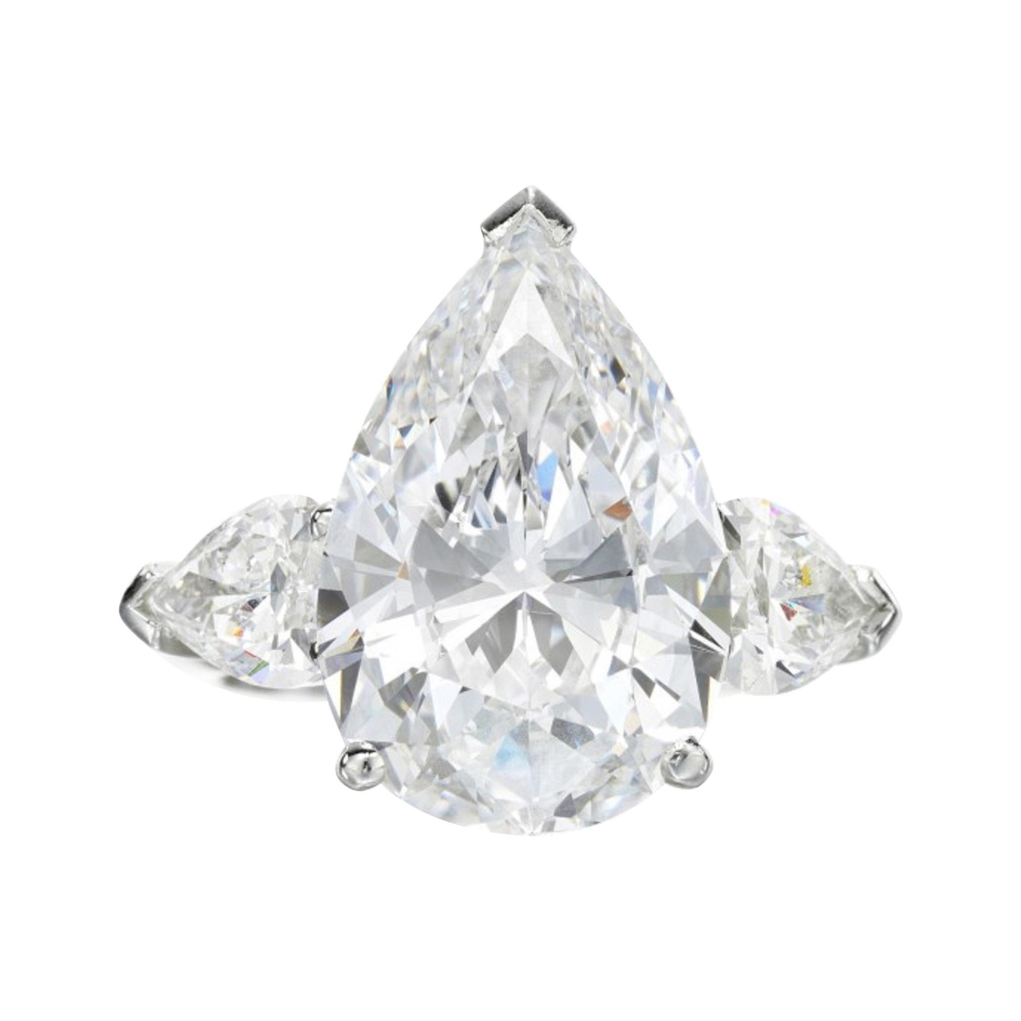 EGL Certified 3 Carat Pear Cut Three Stone Diamond Ring