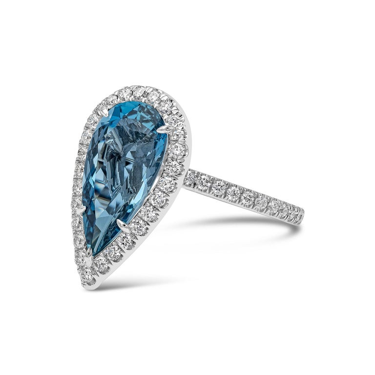 A beautiful engagement ring showcasing a 3.63 carat vivid blue pear shape aquamarine, set in a brilliant diamond halo made in platinum. Diamonds weigh 0.76 carats total. Aquamarine is accompanied with a GIA report.   (size 6, sizable upon