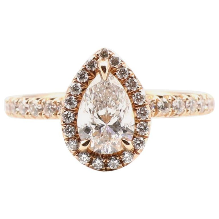 GIA Certified Pear Shape Diamond .90 Carat E SI1 Halo Rose/Pink Gold Ring For Sale