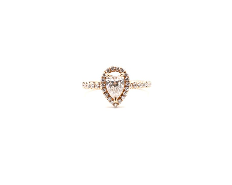 GIA Certified Pear Shape Diamond .90ct E SI1 Halo Rose Pink Gold Engagement Ring Size 6.5   GIA Report Number: 6205999771 (Please note picture of original certificate details as pictured)  Diamond shape: Pear Brilliant Carat weight: 0.90ct Color: