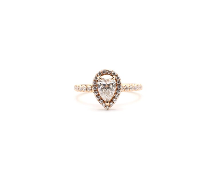 Modern GIA Certified Pear Shape Diamond .90 Carat E SI1 Halo Rose/Pink Gold Ring For Sale