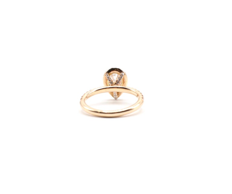 Women's GIA Certified Pear Shape Diamond .90 Carat E SI1 Halo Rose/Pink Gold Ring For Sale