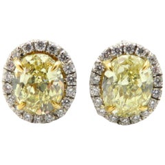 GIA Certified Platinum and 18 Karat Yellow Gold Fancy Oval Diamond Halo Earrings