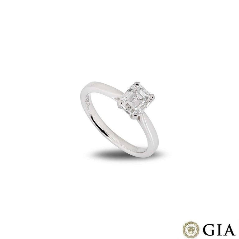 A beautiful emerald cut diamond ring in platinum. The ring comprises of an emerald cut diamond within a classic four claw setting weighing 1.18ct, E in colour and VVS1 clarity. The ring is currently a size UK M - EU 52 - US 6 but can be adjusted for
