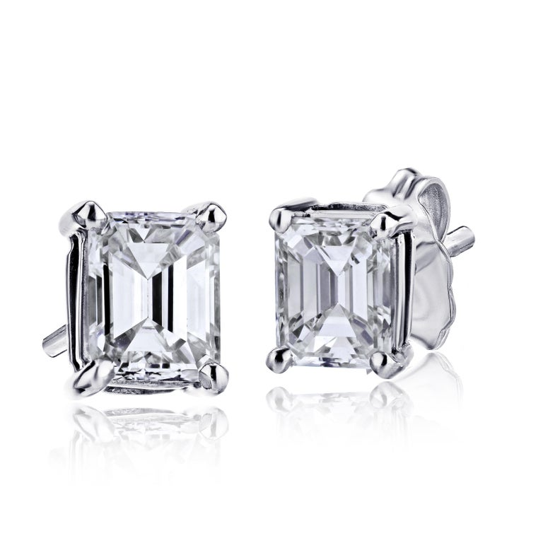 Contemporary GIA Certified Platinum Emerald Cut Diamond Studs 0.75 Carat Total For Sale