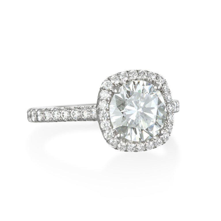 Contemporary GIA Certified Platinum Round Diamond Engagement Ring with Micro Pavé Halo For Sale