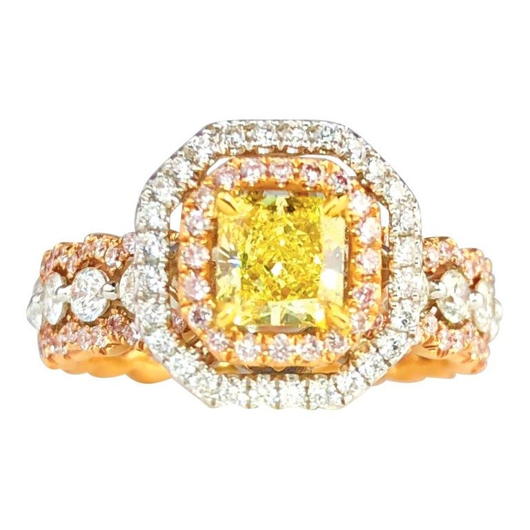 GIA Certified Radiant Cut 0.63 Carat Natural Fancy Intense Yellow Halo Ring For Sale