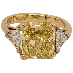 GIA Certified Radiant Cut 5.01 Carat Fancy Intense Yellow Three-Stone Ring