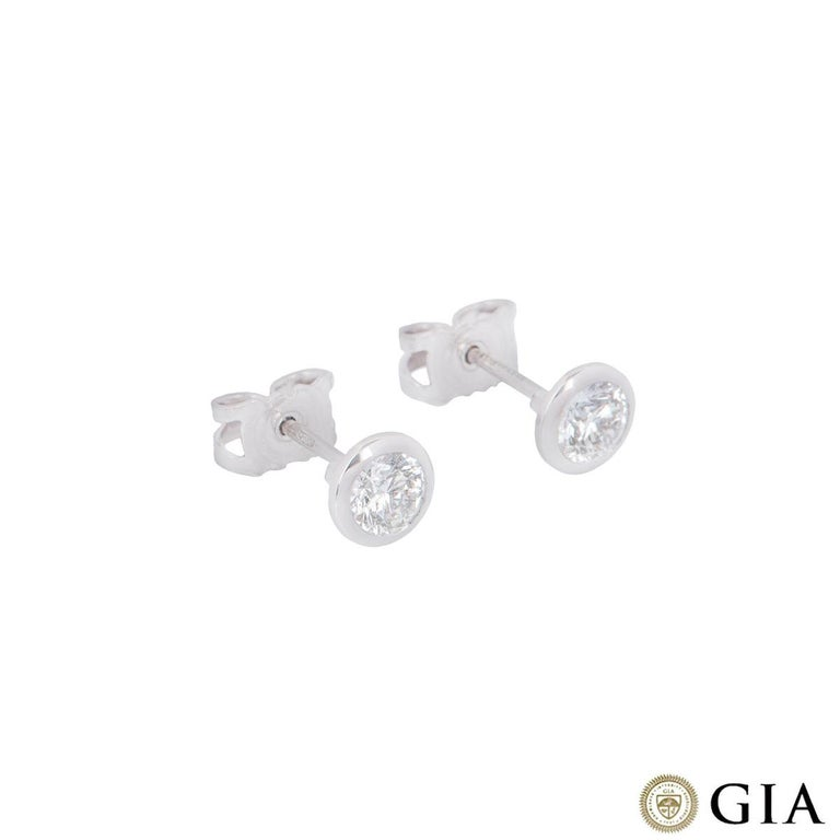 A stunning pair of 18k white gold diamond earrings. Each stud is set with a round brilliant cut diamond in a rubover setting. The first diamond has a weight of 0.37ct and the second weighs 0.38ct, both F colour and VS1 in clarity. The diamonds both
