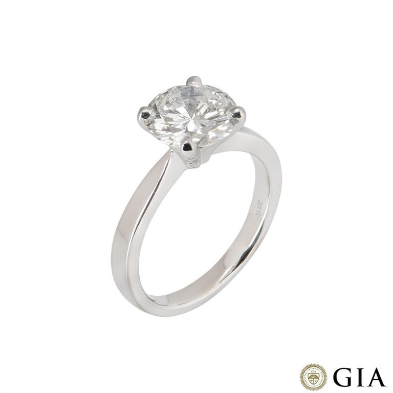A beautiful 18k white gold diamond engagement ring. The central round brilliant cut diamond weighs 2.31ct, is F colour and VVS2 in clarity. The ring is currently a size UK M½/US 6.25/EU 52.5 but can be adjusted for a perfect fit. The ring has a