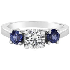 GIA Certified Round Diamond and Blue Sapphire Three-Stone Engagement Ring