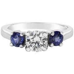 Roman Malakov, Round Diamond and Blue Sapphire Three-Stone Engagement Ring