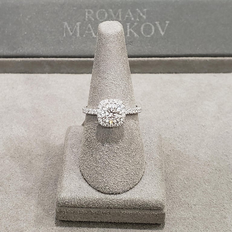 Contemporary GIA Certified Round Diamond Halo Engagement Ring For Sale