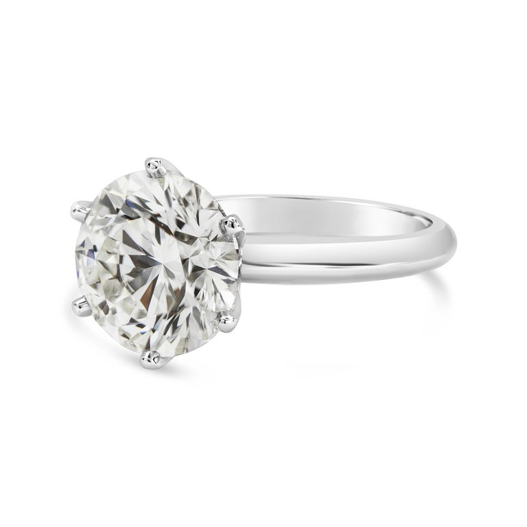 Showcasing a single 5.03 carat round brilliant diamond set in a 6 prong, knife-edge platinum band. GIA certified the diamond as J color, SI1 clarity.  Style available in different price ranges. Prices are based on your selection of the 4C's (Carat,
