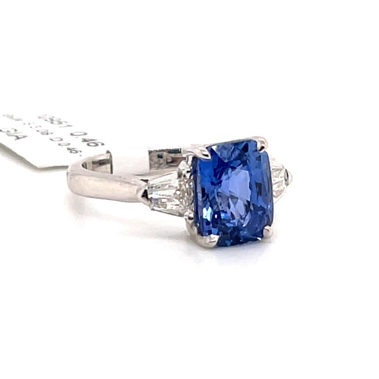 GIA Certified no heat blue Sapphire weighing 3.08 carats flanked with bullet diamonds weighing 0.46 carats, in 18k white gold.