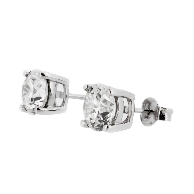Meticulously matched for size, colour, clarity and presence. The sparkling stones are perfectly matched for colour and clarity. This classic pair of earrings elevates the new level of elegance.  GIA Certified Solitaire Stud Diamond Earrings,