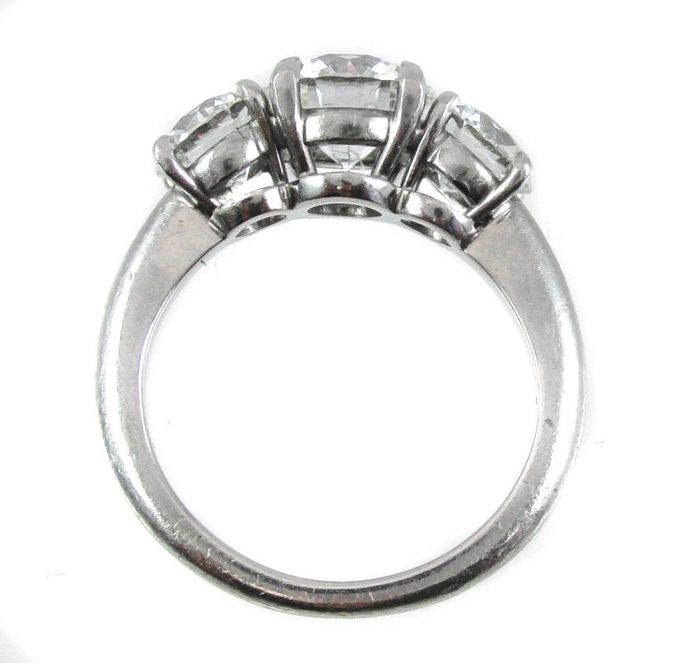 Contemporary GIA Certified Three-Stone Diamond Platinum Engagement Ring For Sale