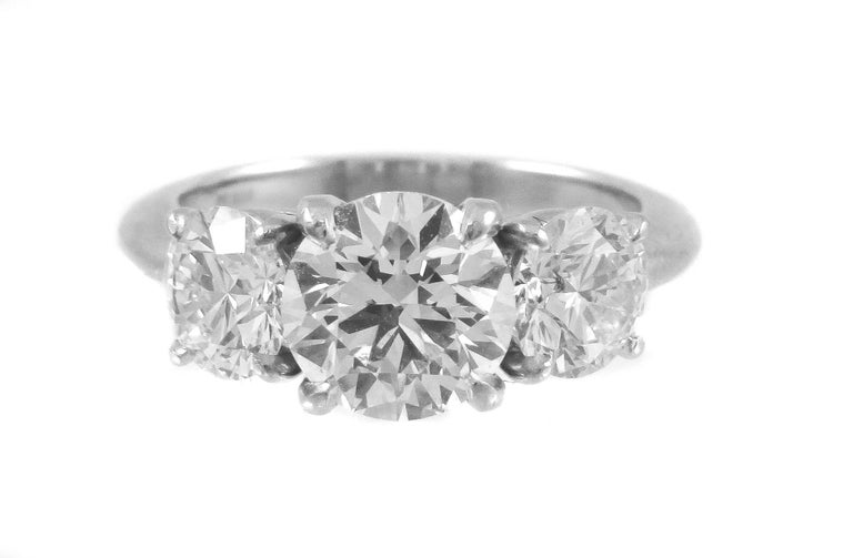 Round Cut GIA Certified Three-Stone Diamond Platinum Engagement Ring For Sale