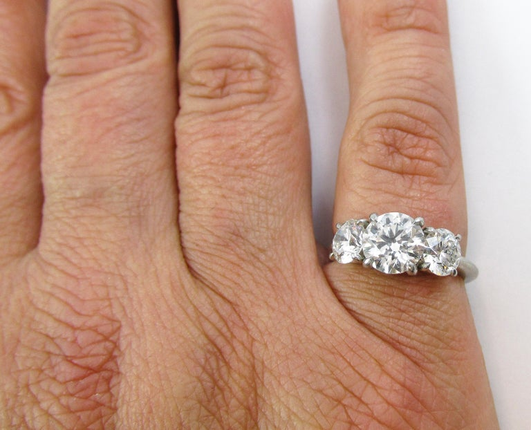 GIA Certified Three-Stone Diamond Platinum Engagement Ring In Excellent Condition For Sale In New York, NY