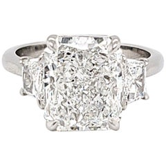 GIA Certified Three-Stone Ring with a 4.40 Carat Radiant Cut Center