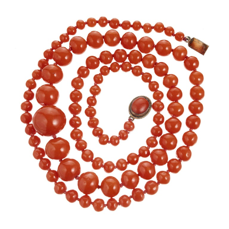 Victorian 1900's all natural orange color well polished Coral necklace. GIA Certified.  105, 13.9 to 5.6mm orange natural color well polished Coral beads. No Dye detected. GIA certificate#2155011. Yellow metal catch with 9 x 7mm oval natural