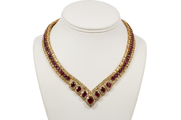 We are pleased to offer this GIA Certified Vintage 18k Yellow Gold Diamond & Ruby Graduated Necklace. This stunning vintage estate piece is finely crafted from 18k yellow gold and features approximately 34.00ctw oval cut rubies, 87 stones in total
