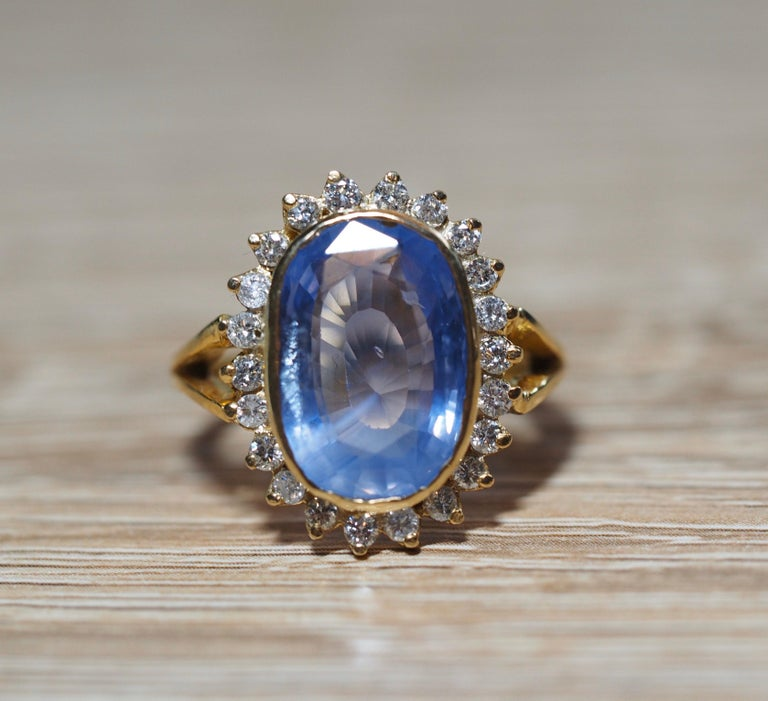 This Vintage GIA Certified Ceylon Sapphire center is absolutely fascinating. It weighs approximately 5.90 carats and measures 15.00 x 10.00 x 4.61 MM.  It is a natural No Heat sapphire that has a