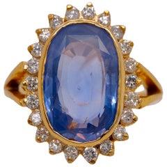 GIA Certified Vintage Ceylon Sapphire Diamond Halo Ring in 14 Karat Yellow Gold