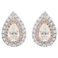 GIA Certified White Diamond and Argyle Pink Diamond in Platinum Stud Earrings
