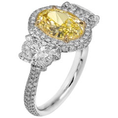 GIA Certifies 3-Stone Ring with 3.52 Carat Fancy Light Yellow Oval Diamond