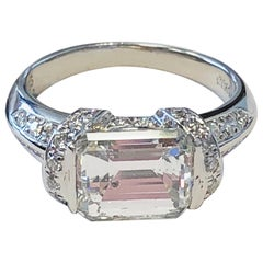 GIA Diamond Emerald Cut and Round Ring in Platinum