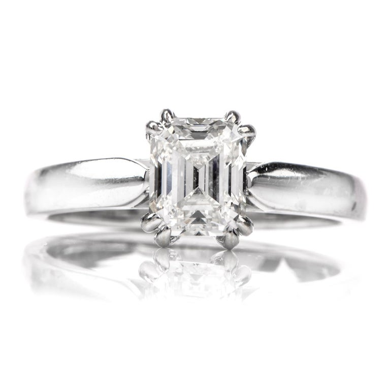 his  classic Solitaire engagement ring crafted in 14k white gold. It exposing an emerald-cut diamond, gia certified  weighing 1.15 carats, and is graded I  color and VS1 clarity, prong set. The sparkling diamond engagement ring remains in excellent