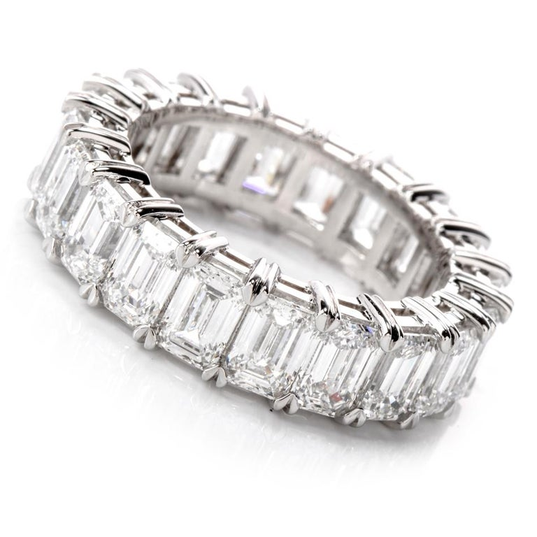 A Bold and Elegance is a statement describing this stunning  GIA Certified Emerald Cut Eternity Band RIng.  20 Vibrant, White high quality Emerald Cut Diamonds wrap around this band from   end to end. weighing approx 6.09 carats. All of D,E,F color.