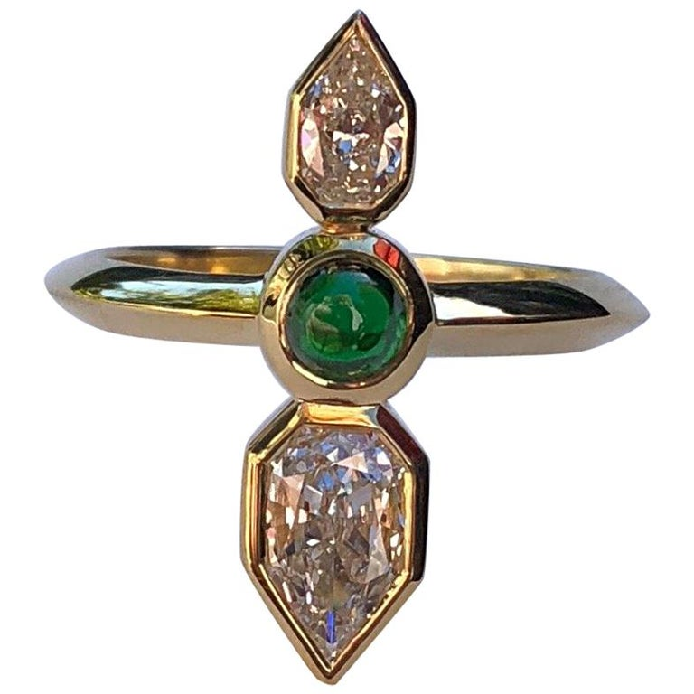 This ring is like an arrow on your finger. Made by hand (hand fabricated) in California with reclaimed and refined 18 karat gold, using a Tsavorite cabochon from Bridges Tsavorite in Kenya, and 2 Empress cut diamonds:  G-VS2/0.54 carat and
