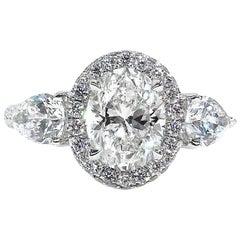 GIA Estate Vintage 3.67 Carat Oval Cut Diamond 3-Stone Halo Platinum Ring