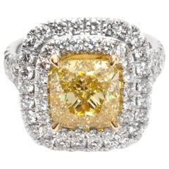 GIA Fancy Intense Yellow Cushion Halo Diamond Ring in 18K Gold VVS2 4.34 Carat